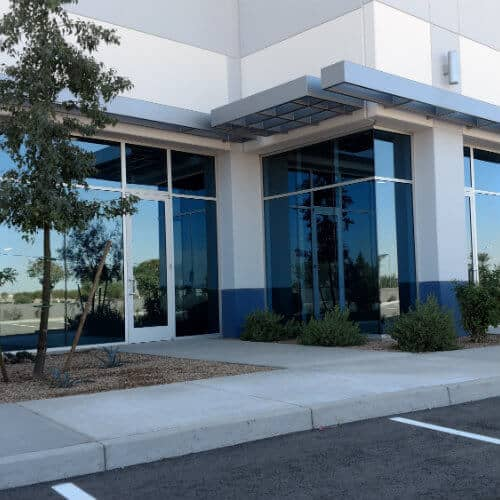 Image of the front of a commercial / business building that has newly installed window glass in Chander AZ