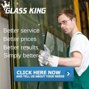 Glass King professional carefully moving a new glass window