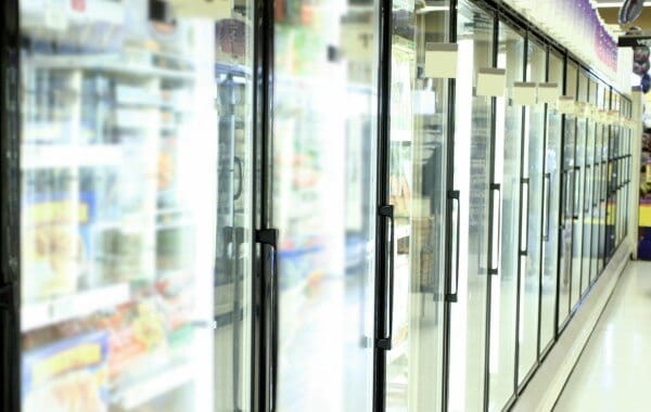 A row of glass fridge doors at a local Chandler AZ supermarket. The doors were recently replaced by the commercial glass repair experts at Glass King.