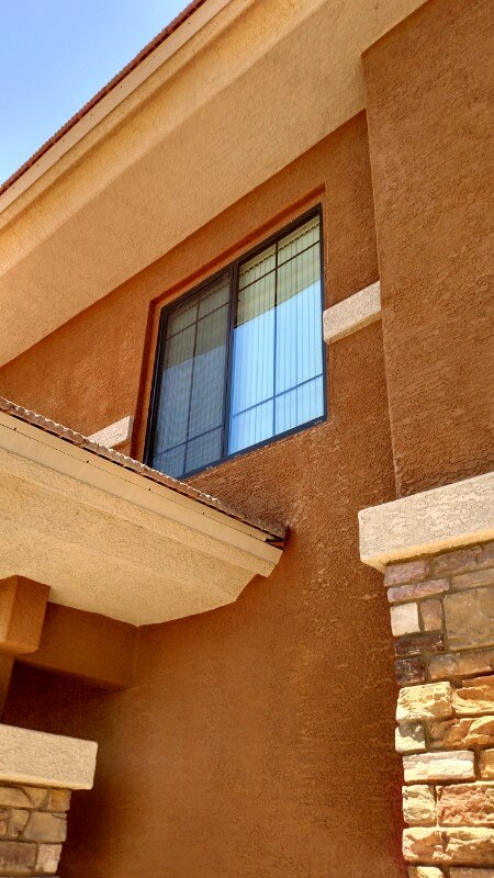 view from the ground up to the 2nd story of a beautiful arizona style home